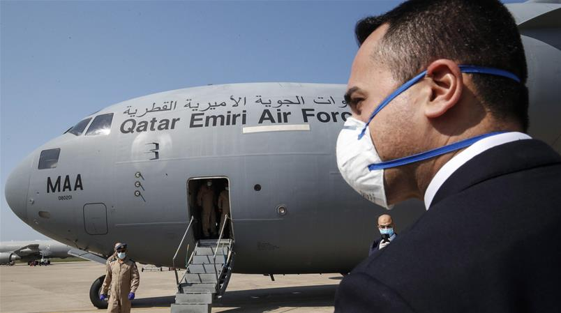 epa08350851 Italian Foreign Affairs Minister Luigi Di Maio (R), wearing a face mask, greets members of the Qatar Armed Forces at the military airport in Pratica di Mare, near Rome, Italy, 08 April 2020, where two flights, one from Ukraine and the other from Qatar, arrived to bring medical aid for Italy during the ongoing coronavirus crisis. EPA/GIUSEPPE LAMI